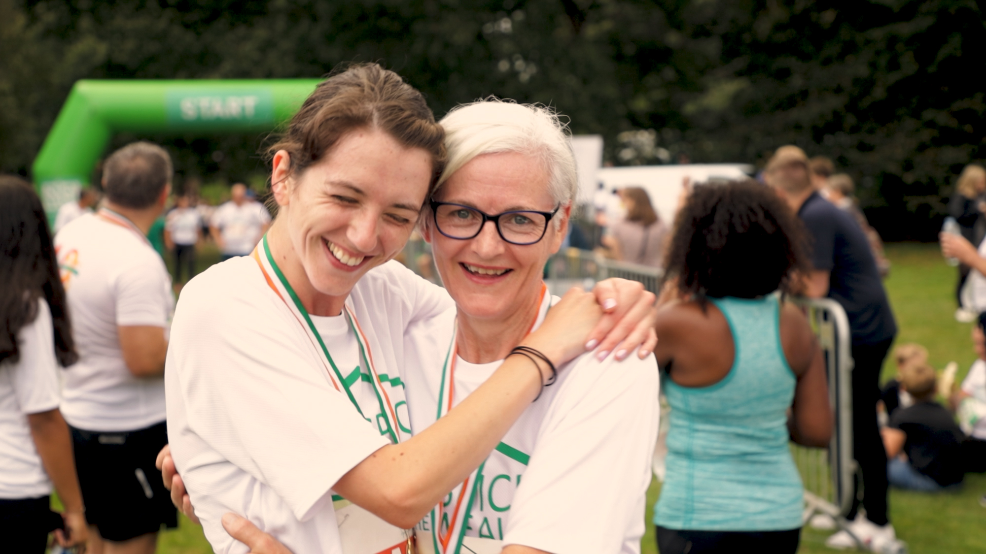 Embracing at the finish line of Hospice Run 2021