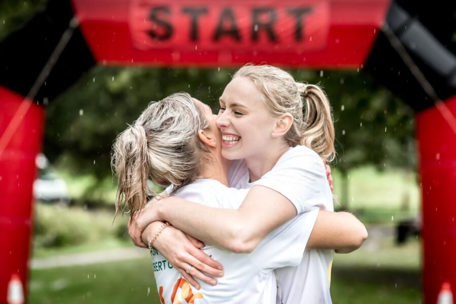 Hospice Run Ladies Hugging at the start line
