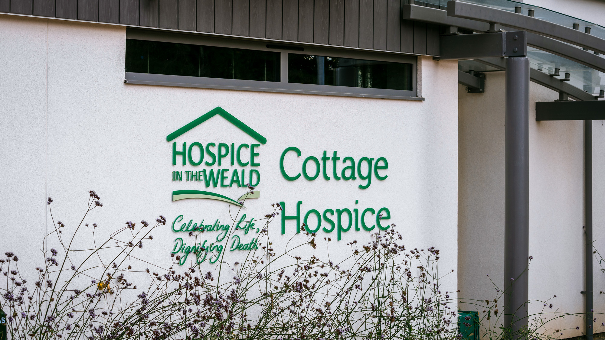 Cottage hospice sign outside our building in Five Ashes