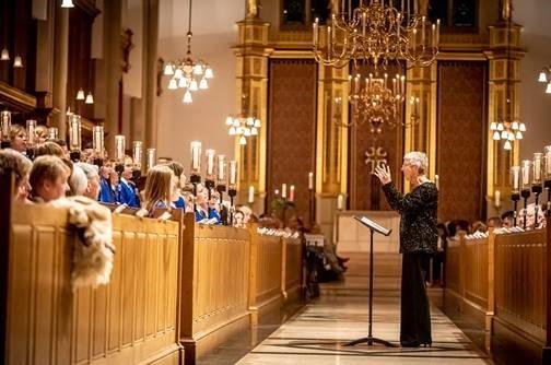Conductor with Choir in church