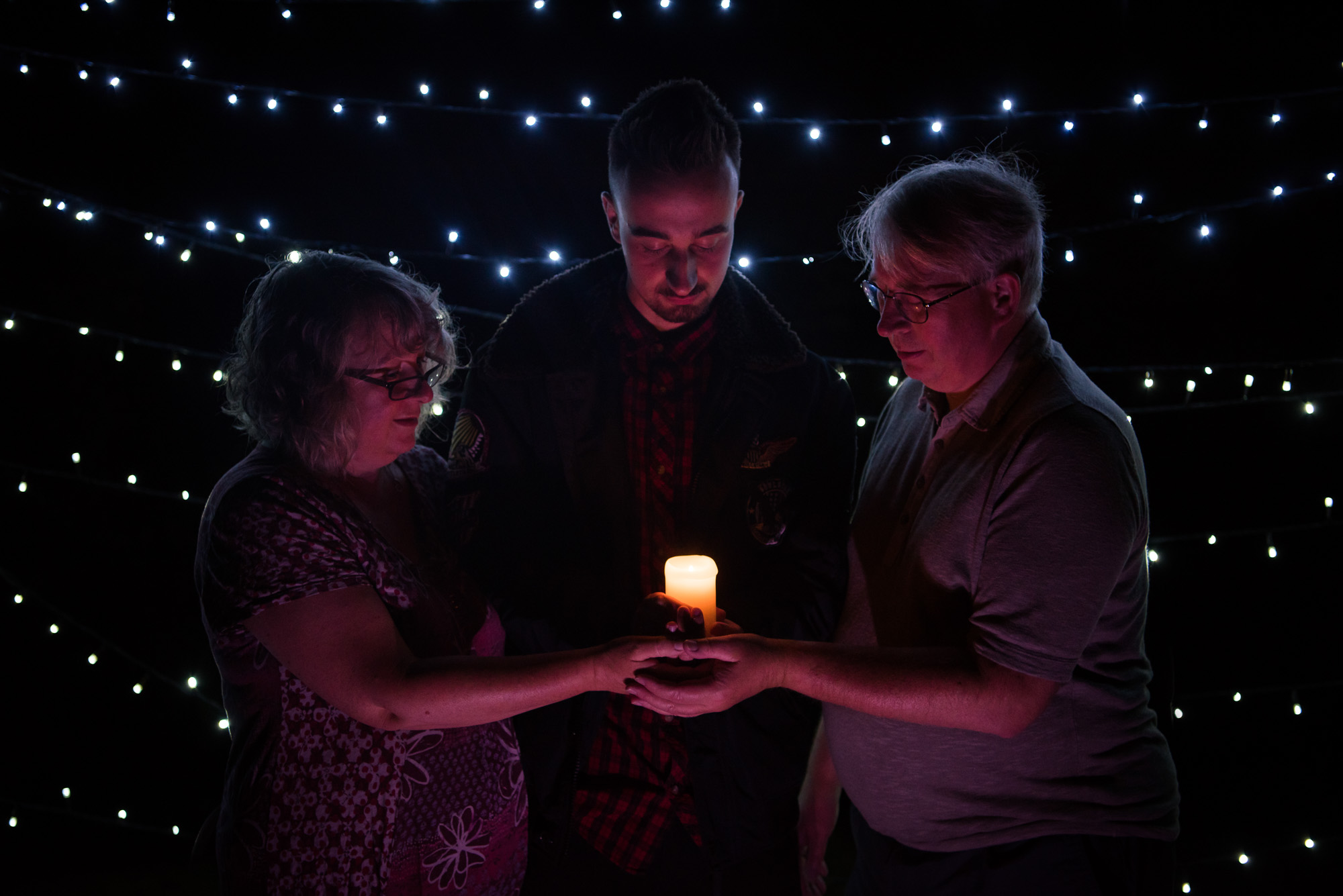 Family holding a candle at Light up a life