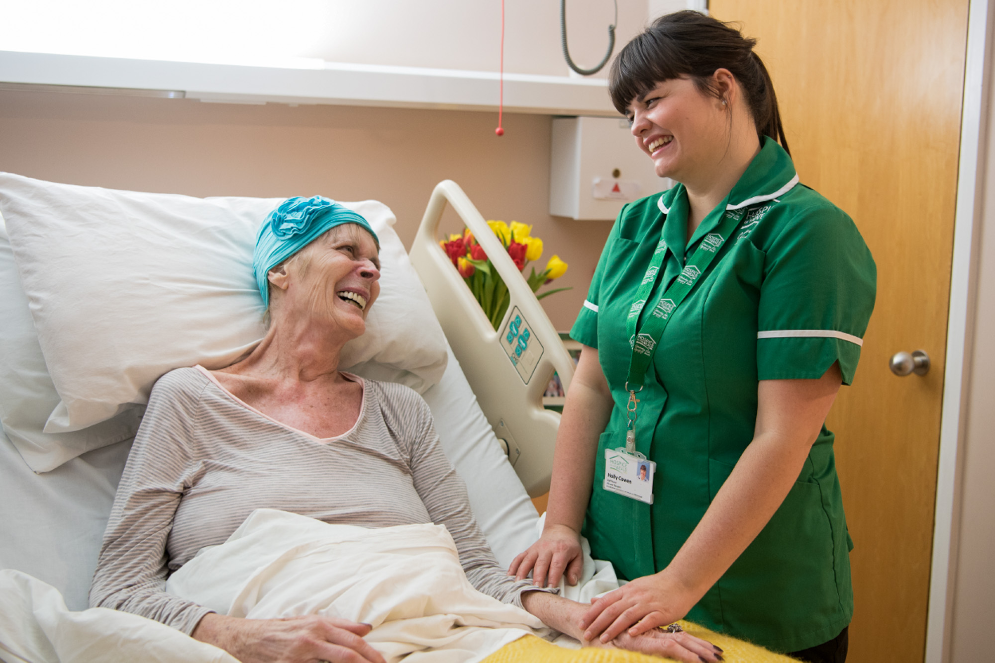 Nurse with patient on the ward