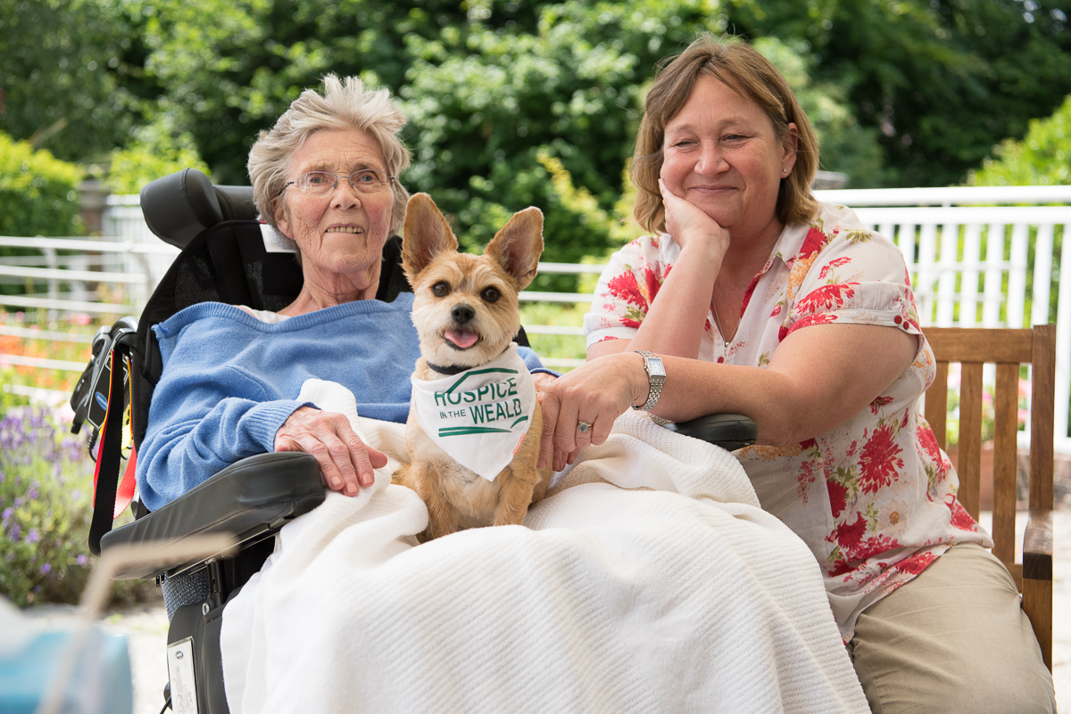 Patient, Daughter and therapy dog in Hospice Gardens