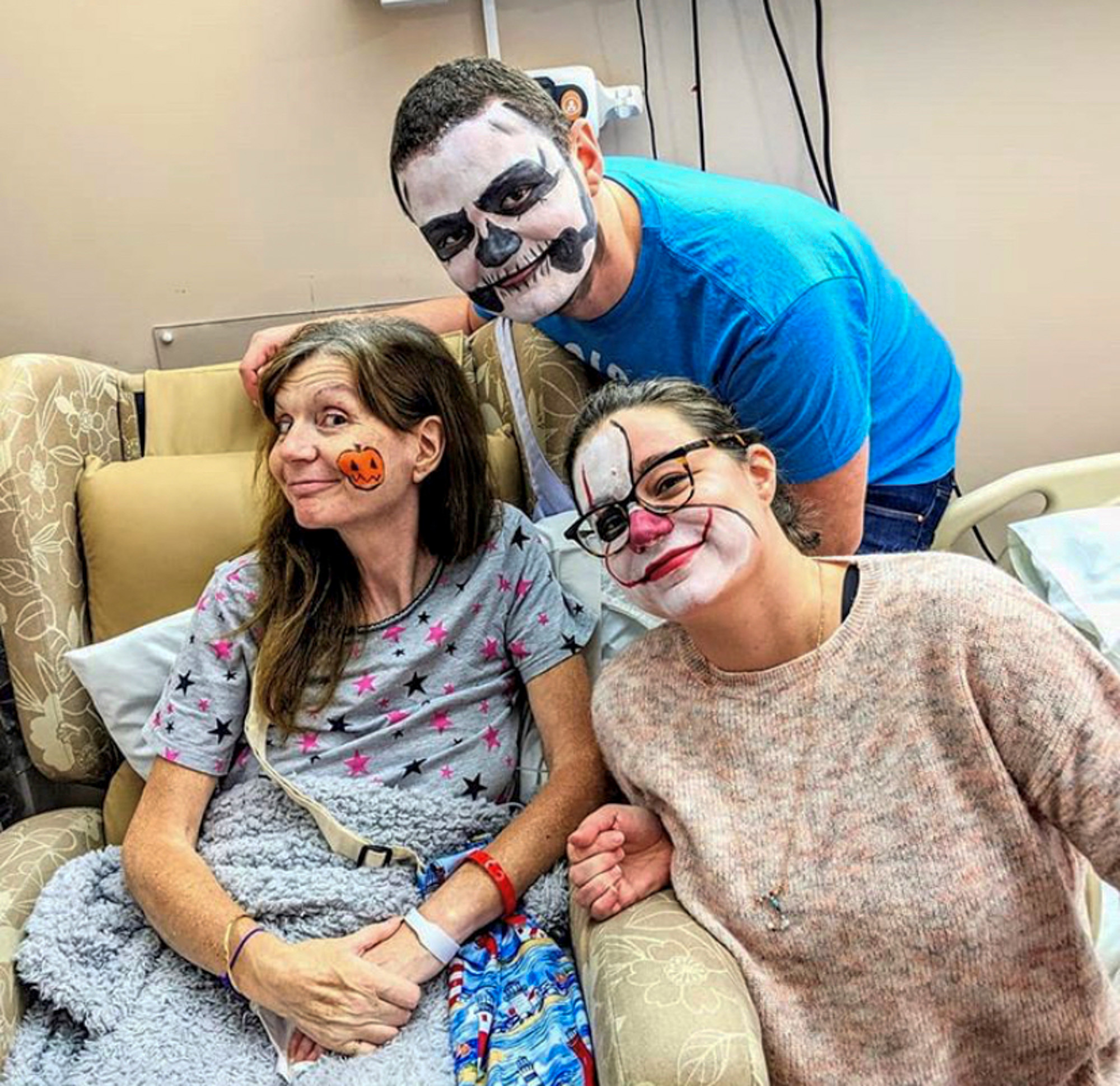Sarah and her children enjoying face painting at Halloween on the In Patient Ward