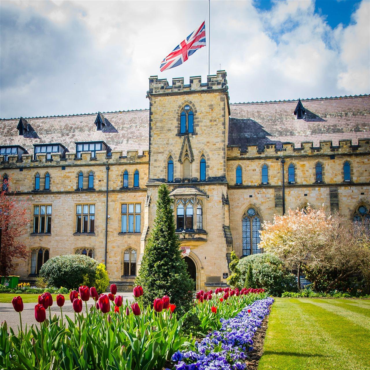 Tonbridge School Tower flying flag in gardens