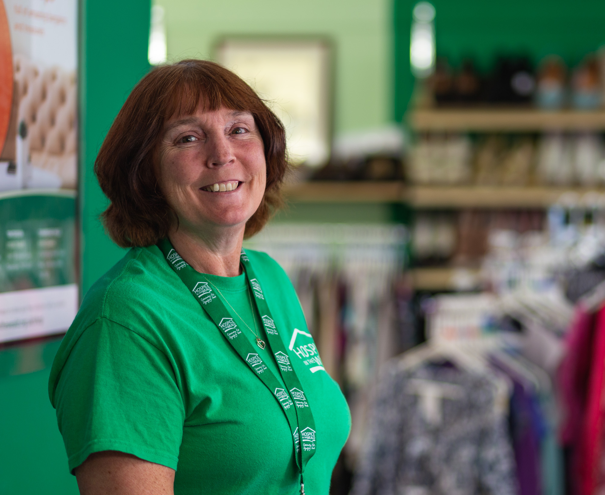 Volunteer smiling in our West Malling Shop