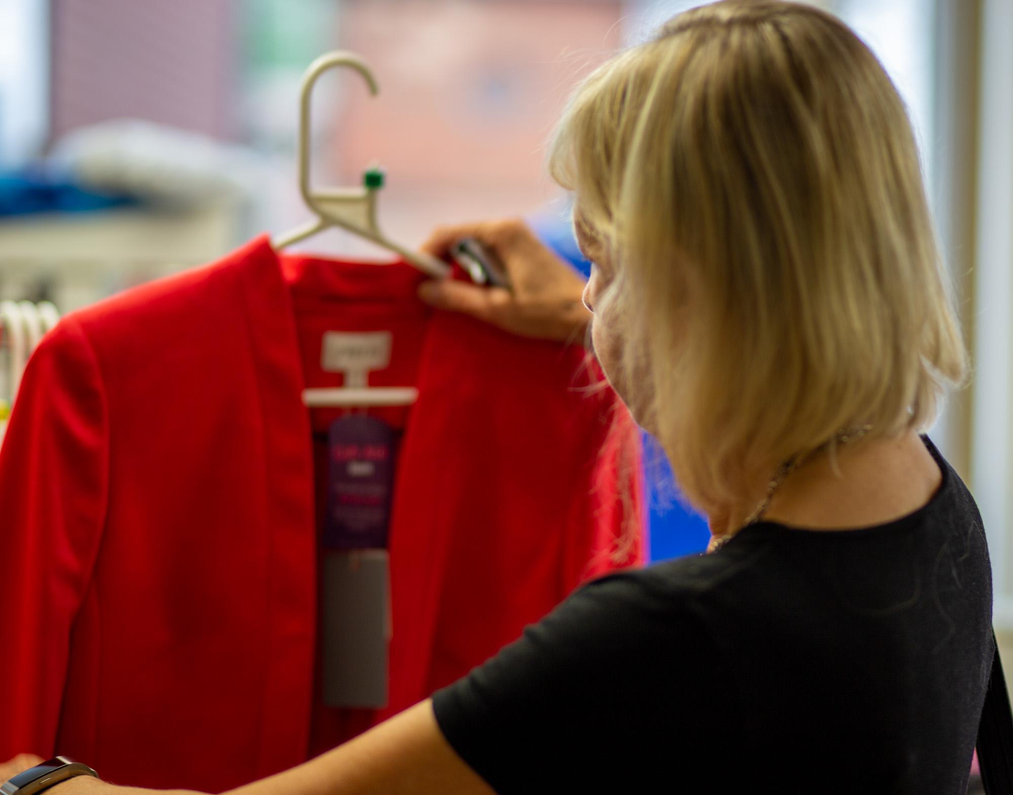 Shopper admiring red jacket