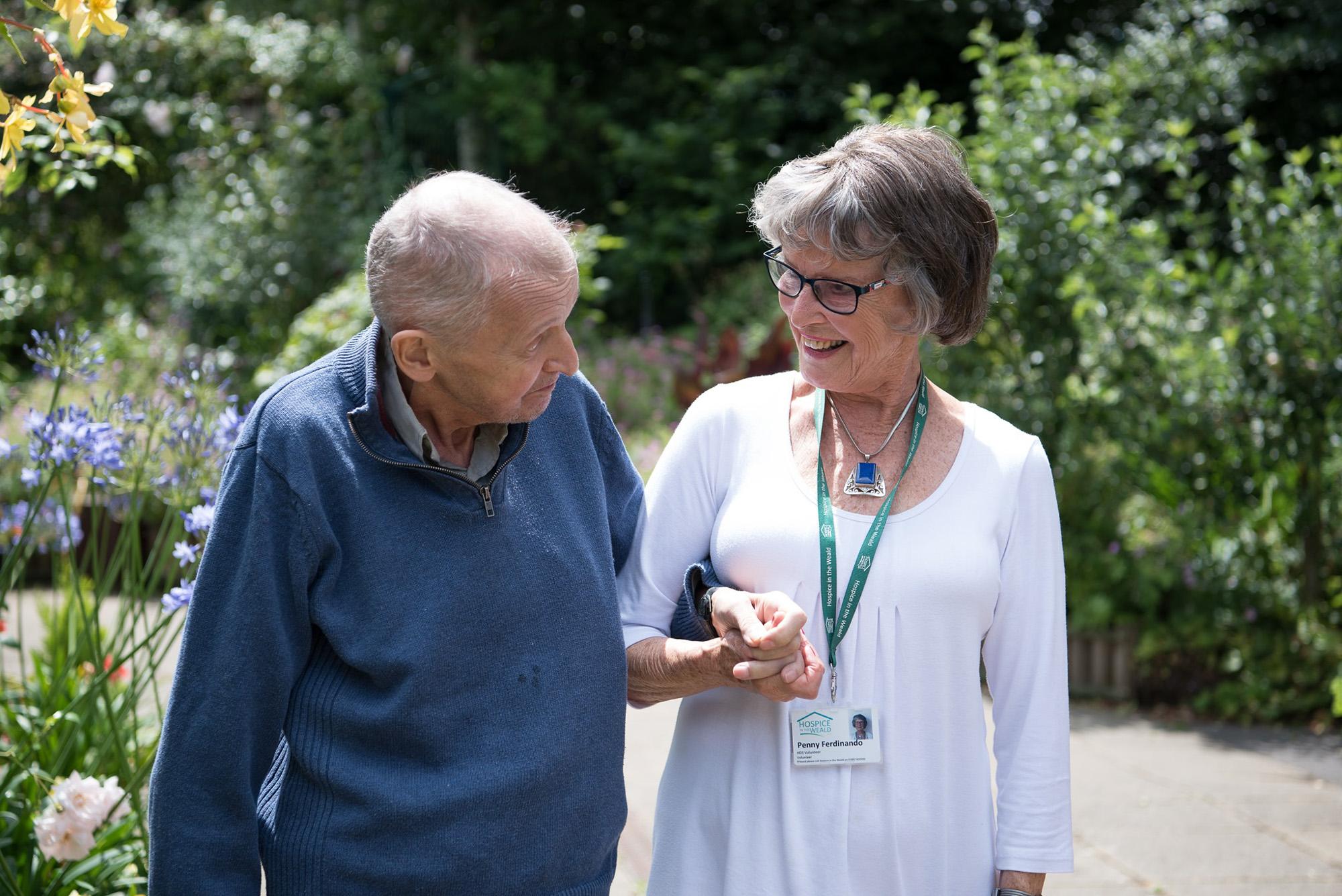 volunteer with patient in the gardens
