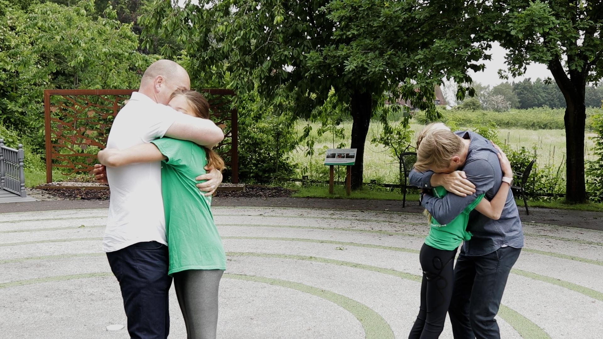 Aurora and Bertie hug their dads