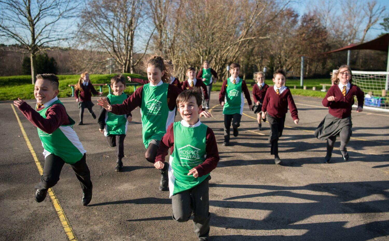 School Children running across playground fundraising