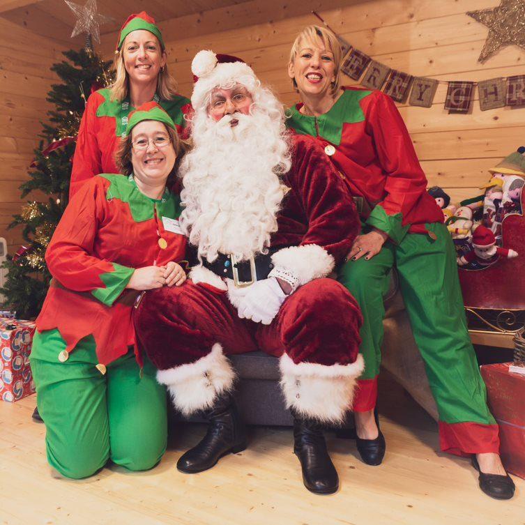 Santa and his volunteer helpers at the Christmas Market