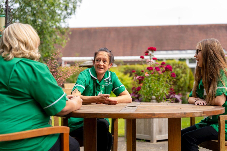 Nurses outside having a conversation